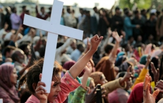 ISLAMABAD, PAKISTAN - MARCH 26:  Pakistani Christians hold cross during the protest against the demolition of Christian streets in Islamabad, Pakistan on March 26, 2014. Pakistani Minister of Internal Affairs Nisar Ali Khan explains Christian streets will be demolished from city center following that Pakistani Christians stage a protest. (Photo by Metin Aktas/Anadolu Agency/Getty Images)